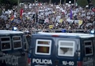 Thousands of protesters rallied again Saturday in Spain, pictured here, where the government submitted an austerity budget and said the public debt and deficit are set to rise far above earlier forecasts