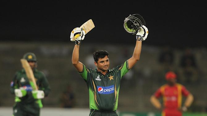 Pakistan's captain Azhar Ali acknowledges his century against Zimbabwe during the second one-day international at Gaddafi Stadium in Lahore, Pakistan, Friday, May 29, 2015. Ali notched a century on Friday and led Pakistan to a six-wicket victory over Zimbabwe in the second one-day international for an unbeatable 2-0 lead in the three-match series. (AP Photo/K.M. Chaudary)
