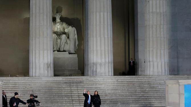 U.S. President-elect Trumpwaves with wife Melania at pre-inaugural rally at the Lincoln Memorial in Washington