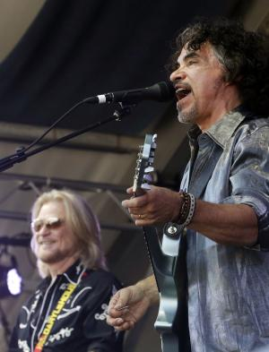 Daryl Hall and John Oates, right, perform at the New Orleans Jazz and Heritage Festival in New Orleans, Sunday, May 5, 2013. (AP Photo/Gerald Herbert)
