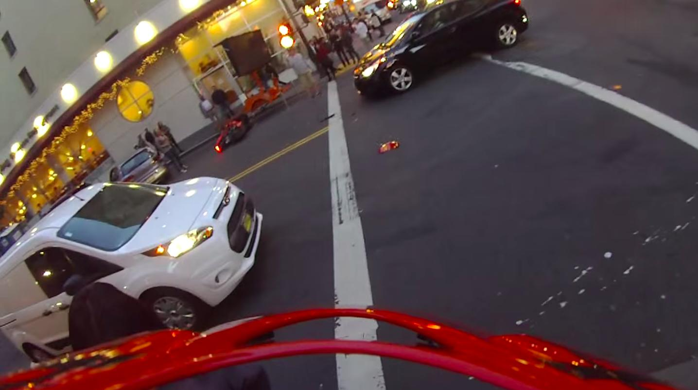 Watch a man on a motorcycle get hit by a car and land on his feet, all in first-person