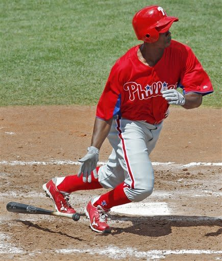 Pierre, Pineiro help Phillies tie Rays