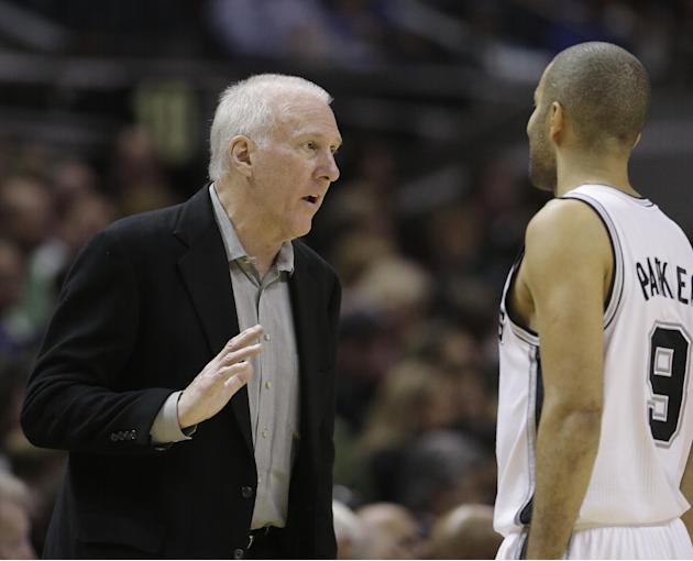 San Antonio Spurs coach Gregg Popovich, left, talks with Tony Parker during the second half on an NBA basketball game against New York Knicks, Thursday, Jan. 2, 2014, in San Antonio. New York won 105-