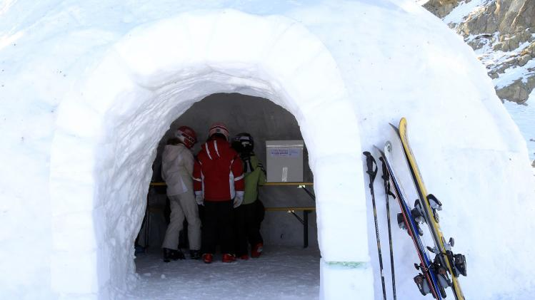 Children stand inside an igloo that is the highest polling station in Italy for the primary elections to choose the Democratic Party's leader, at 2,585m (8480 ft) above sea level on the Presena