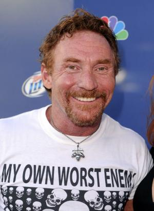"""In this Sept. 18, 2008 photo, Danny Bonaduce poses as he arrives at NBC's Fall Premiere Party, in Los Angeles. Former child TV star Danny Bonaduce says a crazed fan bit him during an event at a Washington state casino. The former """"Partridge Family"""" actor tells The News Tribune of Tacoma that the woman asked him if she could kiss him and then sank her teeth into his cheek for about a minute until others pulled her off. Bonaduce, who works these days as a radio disc jockey in Seattle, said the woman was taken into custody Friday, Sept. 28, 2012, but he doesn't plan to press charges. (AP Photo/Mark J. Terrill)"""