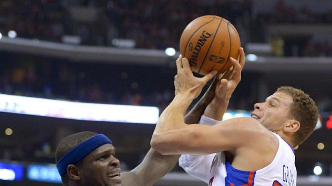 Los Angeles Clippers forward Blake Griffin, right, shoots over Memphis Grizzlies forward Zach Randolph during the first half of Game 2 of a first-round NBA basketball playoff series, Monday, April 22, 2013, in Los Angeles.  (AP Photo/Mark J. Terrill)