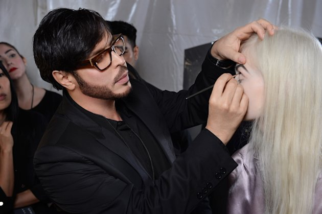 This Sept. 10, 2012 photo shows make-up artist Francois Nars, preparing a model for the Marc Jacobs Spring 2013 collection during Fashion Week in New York. Nars&#39; company has taken on Andy Warhol&#39;s silvery Factory, silkscreened superstars and avant-garde films in a limited-edition cosmetic collection, exclusive to Sephora stores until Nov. 1. (AP Photo/Nars Cosmetics)