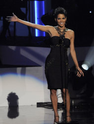 Actress Halle Berry introduces singer Jennifer Hudson onstage at &quot;We Will Always Love You: a Grammy Salute to Whitney Houston,&quot; at Nokia Theatre on Thursday, Oct. 11, 2012, in Los Angeles. The one-hour concert tribute will air on CBS on Nov. 16. (Photo by Chris Pizzello/Invision/AP)
