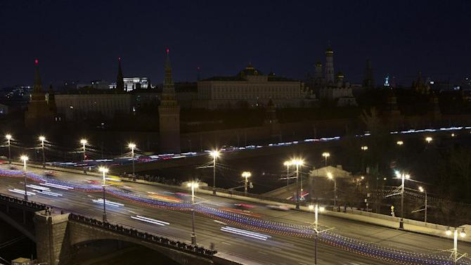 The lights are turned off at the Kremlin to mark Earth Hour in Moscow, Russia, on Saturday, March 28, 2015. Earth Hour is marked around the world, with millions expected turn out the lights to raise awareness about climate change. (AP Photo/Denis Tyrin)