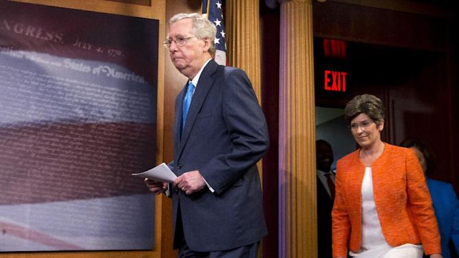 Senate Majority Leader Mitch McConnell of Ky.,  followed by Sen. Joni Ernst, R-Iowa, arrives for a news conference on Capitol Hill in Washington, Wednesday, July 29, 2015, to speak about Planned Parenthood.   (AP Photo/Manuel Balce Ceneta)