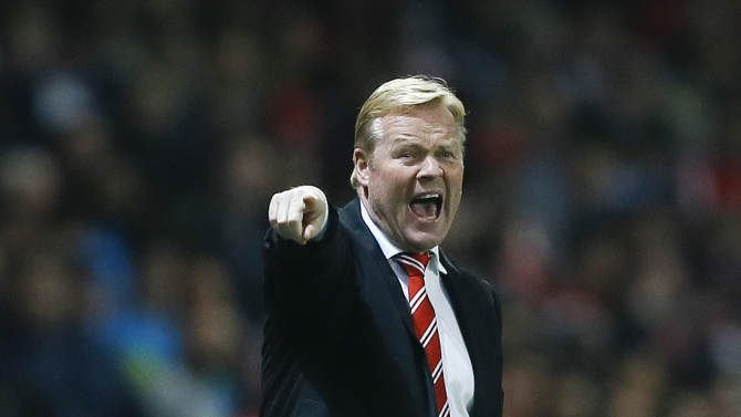 Southampton's manager Ronald Koeman shouts to his players during the English League Cup soccer match between Arsenal and Southampton at Emirates Stadium in London, Tuesday, Sept. 23, 2014. (AP Photo/Kirsty Wigglesworth)
