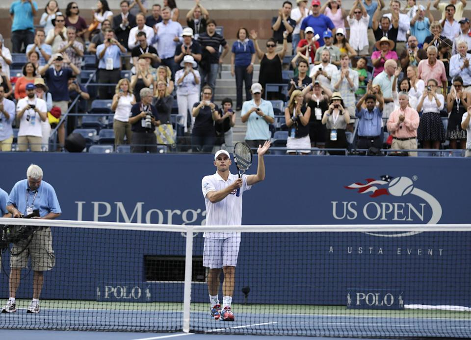 Fans applaud as Andy Roddick waves after his fourth round loss to Argentina's Juan Martin Del Potro at the 2012 US Open tennis tournament, Wednesday, Sept. 5, 2012, in New York. Roddick said he would retire after the match. (AP Photo/Charles Krupa)