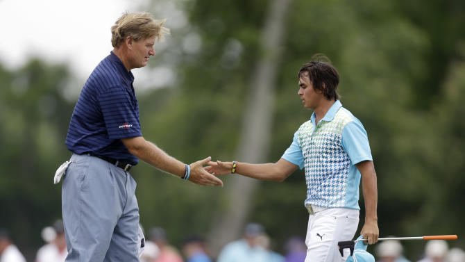 Ernie Els shakes hands with Ricky Fowler, left, after they finished for the day on the ninth hole during the second round of the PGA Zurich Classic golf tournament at TPC Louisiana in Avondale, La., Friday, April 26, 2013. (AP Photo/Gerald Herbert)