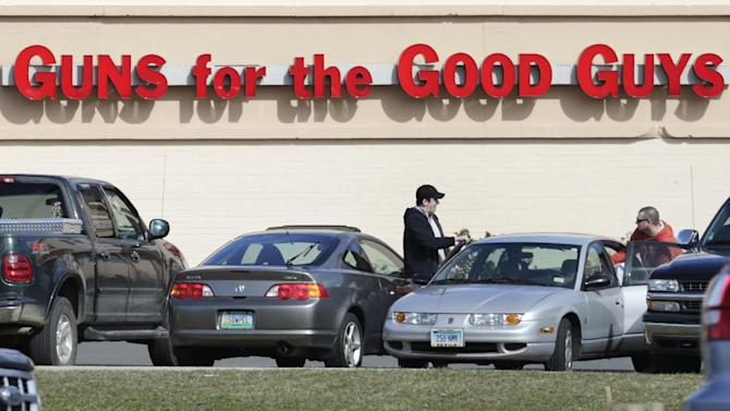 Shoppers leave Hoffman's Gun Center with their purchases in Newington, Conn., Tuesday, April 2, 2013. Customers are packing gun stores around Connecticut following the unveiling of new gun-control legislation, which could take effect as soon as Wednesday evening. (AP Photo/Charles Krupa)