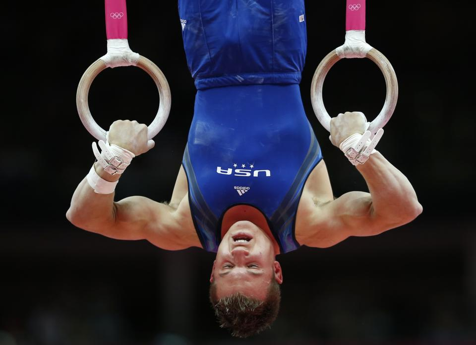 U.S. gymnast Jonathan Horton performs on the rings during the Artistic Gymnastics men's qualification at the 2012 Summer Olympics, Saturday, July 28, 2012, in London. (AP Photo/Matt Dunham)