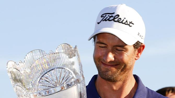 Adam Scott, of Australia, holds the trophy after winning The Barclays golf tournament on Sunday, Aug. 25, 2013, in Jersey City, N.J. (AP Photo/Rich Schultz)