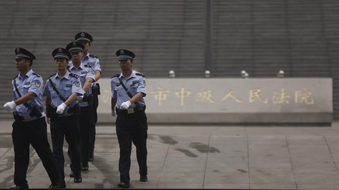 Policemen patrol near the entrance of the Jinan Intermediate People's Court where the trial of disgraced Chinese politician Bo will be held, in Jinan