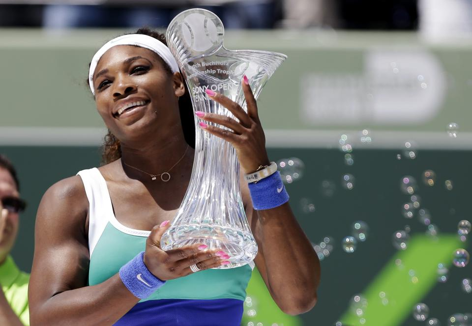 Serena Williams holds the trophy after defeating Maria Sharapova, of Russia, in the final of the Sony Open tennis tournament, Saturday, March 30, 2013, in Key Biscayne, Fla. Williams won 4-6, 6-3, 6-0. (AP Photo/Lynne Sladky)