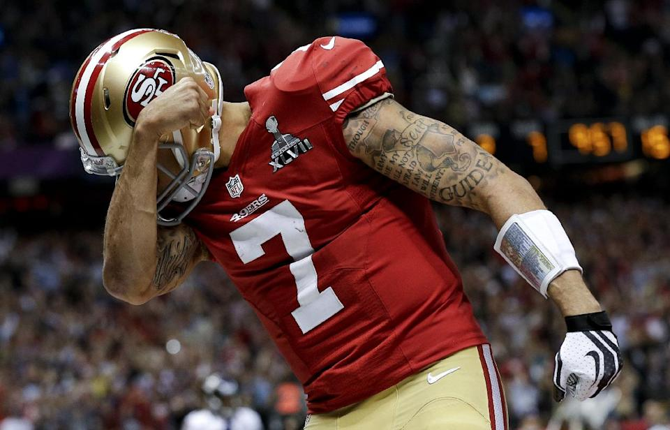 San Francisco 49ers quarterback Colin Kaepernick celebrates his touchdown against the Baltimore Ravens during the second half of the NFL Super Bowl XLVII football game, Sunday, Feb. 3, 2013, in New Orleans. (AP Photo/Dave Martin)