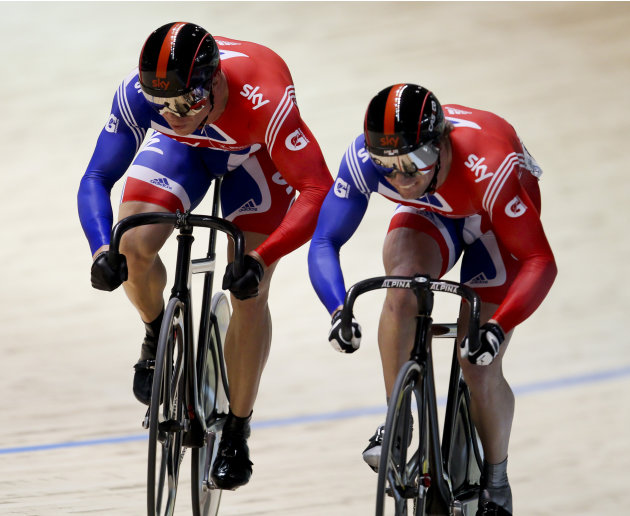 Jason Kenny (R) from Britain races compatriot Chris Hoy (L) in the men's sprint at the 2012 Track Cycling World Championships in Melbourne, on April 7, 2012.  AFP PHOTO / Mark GUNTER  IMAGE STRICT