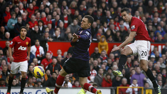 Manchester United's Robin van Persie, right, scores past Arsenal's Thomas Vermaelen, center, during their English Premier League soccer match at Old Trafford Stadium, Manchester, England, Saturday, Nov. 3, 2012. (AP Photo/Jon Super)