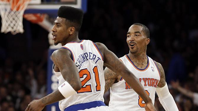 New York Knicks' Iman Shumpert (21) and J.R. Smith (8) celebrate after Shumpert hit a three-point basket during the first half of an NBA basketball game against the Memphis Grizzlies, Wednesday, March 27, 2013, in New York. (AP Photo/Frank Franklin II)