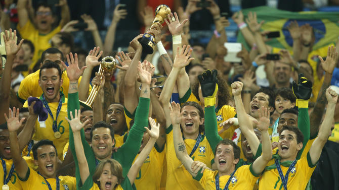 Brazil players celebrate with the trophy after winning the soccer Confederations Cup final between Brazil and Spain at the Maracana stadium in Rio de Janeiro, Brazil, Sunday, June 30, 2013. (AP Photo/Bruno Magalhaes)