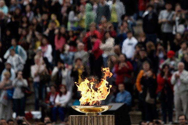 Greece hands Olympic flame over to Britain