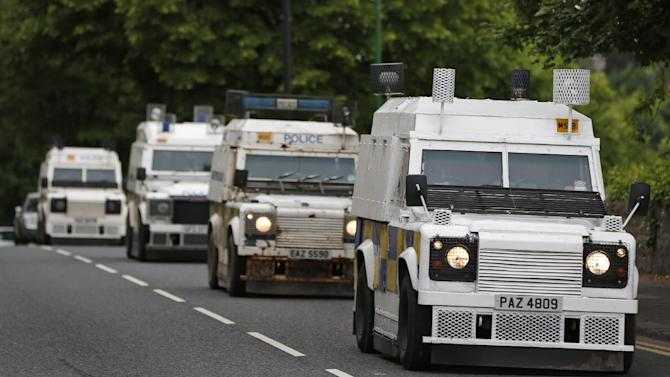 Police trucks patrol the streets around the G8 summit venue in Enniskillen, Northern Ireland on Sunday, June 16, 2013. In a two-day meeting, beginning on Monday, global leaders will discuss the economy and exchange views on foreign affairs and security issues. (AP Photo/Lefteris Pitarakis)