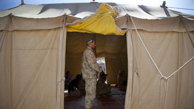An Afghan National policeman joins others for Friday prayers in a tent at their base in Marjah, Helmand Province, Afghanistan, Friday Oct 19, 2012. Afghanistan's police are routinely targeted by insurgent attacks in southern Afghanistan, one of the deadliest regions in the country. (AP Photo/Anja Niedringhaus)