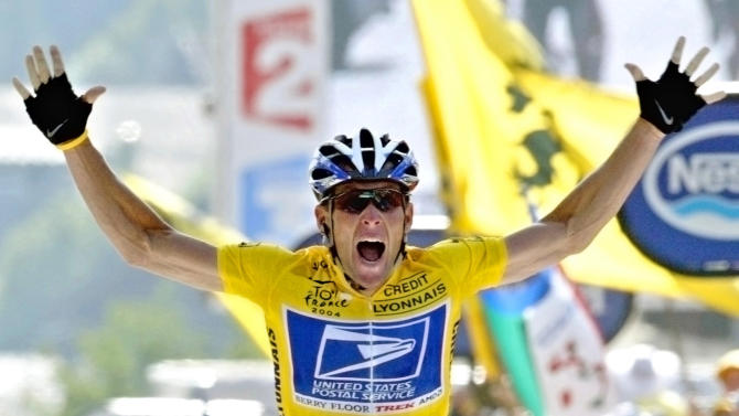 FILE - In this July 22, 2004, file photo, Lance Armstrong reacts as he crosses the finish line to win the 17th stage of the Tour de France cycling race between Bourd-d'Oisans and Le Grand Bornand, French Alps. In 2004, Armstrong was also named Associated Press Male Athlete of the Year and ESPN's ESPY Award for Best Male Athlete. (AP Photo/Laurent Rebours, File)