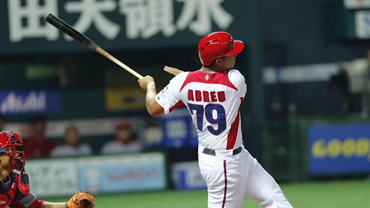 Cuba's first baseman Jose Abreu hits a grand slam off China's Liu Yu in the fifth inning of their World Baseball Classic first round game in Fukuoka, Japan, Monday, March 4, 2013. (AP Photo/Koji Sasahara)