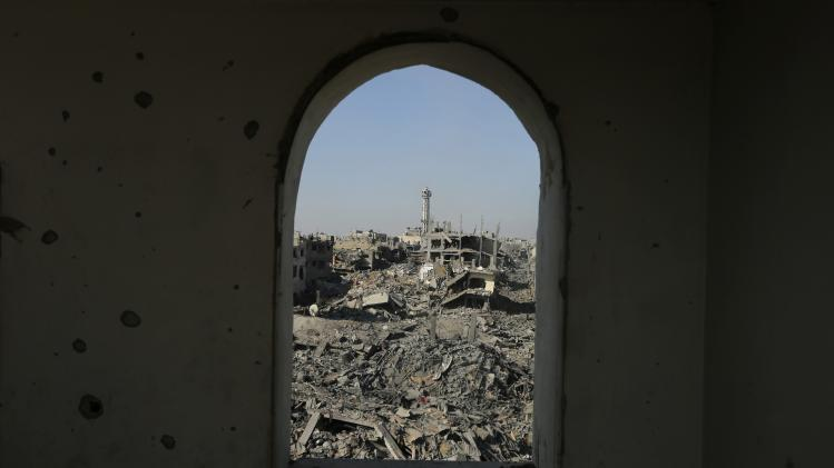Destruction is pictured through the window of a mosque in Shejaia neighborhood in the east of Gaza City
