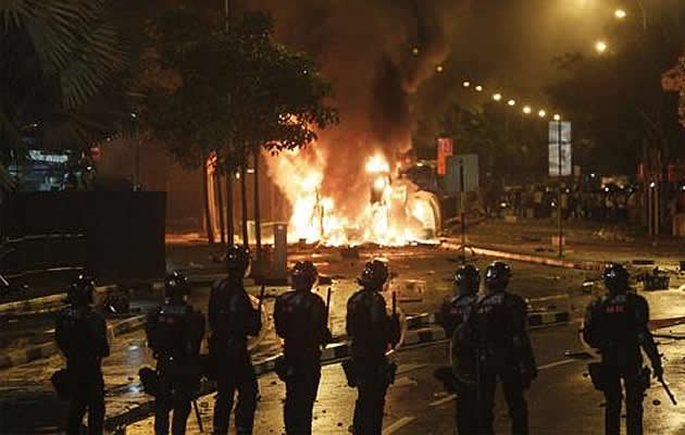 Singapore prosecutors on Tuesday charged 24 Indian workers for taking part in the city-state's first riot in more than 40 years. (The Malaysian Insider photo)