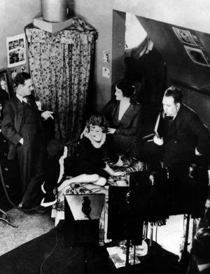 """FILE - In this 1929 file photo, British director Alfred Hitchcock, right, is pictured at the set directing the first British full-length talking picture """"Blackmail.""""  The New Zealand Film Archive and the National Film Preservation Foundation announced the discovery of the 1923 film """"The White Shadow,"""" thought to be the earliest surviving feature by Alfred Hitchcock. (AP Photo, file)"""
