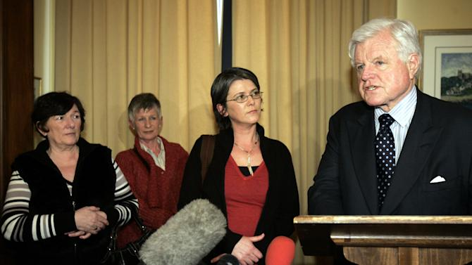 CORRECTS THE FIRST NAME OF PERSON KILLED ON TUESDAY MAY 5, 2015  FILE - This is a Wednesday, March 15, 2006  file photo of Sen. Edward M. Kennedy, D-Mass., as he  speaks to the press as he stands with members of Robert McCartney's family, from left, mother Kathleen McCartney, aunt Emily McCartney, and sister Catherine McCartney, following their meeting on Capitol Hill Washington. Gerard Davison the central Irish Republican Army figure in one of the outlawed group's most notorious killings has been shot to death in Belfast, residents and police said Tuesday May 5, 2015. Davison was a Belfast IRA commander when he allegedly ordered henchmen in 2005 to attack a man, Robert McCartney, who had insulted him in a pub. McCartney's sisters took their demands for justice all the way to the White House, and their embarrassing campaign helped spur the IRA to renounce violence and disarm later that year. (AP Photo/Susan Walsh, File)