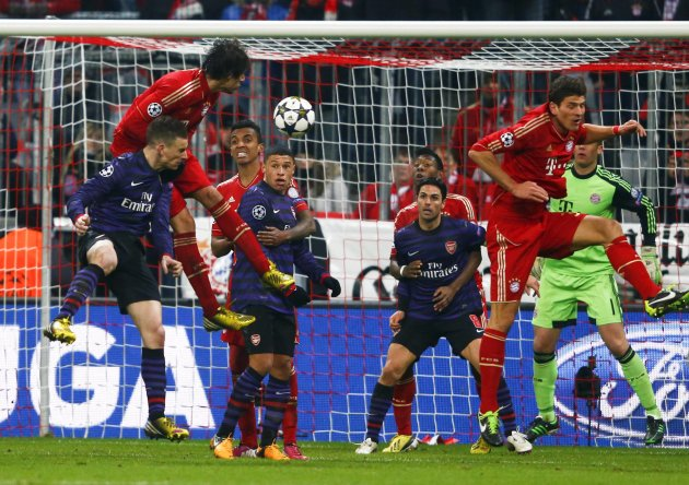 File photo of Arsenal's Koscielny scoring a header goal against Bayern Munich during Champions League match in Munich