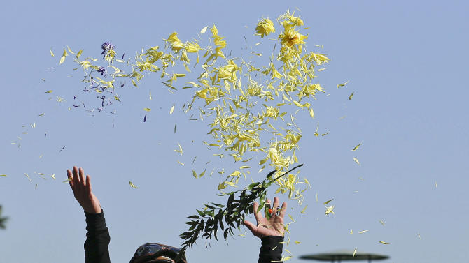 Jockey Mike Smith tosses flower petals in the air after riding Mizdirection to win the Breeders' Cup Turf Sprint horse race, Saturday, Nov. 3, 2012, at Santa Anita Park in Arcadia, Calif. (AP Photo/Gregory Bull)