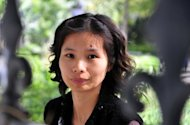 File photo of Chinese dissident Zeng Jinyan, who has said on Twitter that she was placed under house arrest, a day after fellow activist Chen Guangcheng left the US embassy after a high-stakes diplomatic standoff