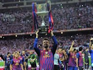 Barcelona&#39;s Gerard Pique lifts the Spanish Cup after defeating Athletic Bilbao on May 25. Barcelona gave coach Pep Guardiola the perfect send off, beating Athletic Bilbao 3-0 to win the Spanish Cup in the coach&#39;s last match in charge after a memorable four seasons