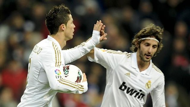 Cristiano Ronaldo celebates with Esteban Granero, who will join QPR from Real Madrid