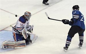 Colorado Avalanche's Milan Hejduk scores the first goal in the shoot out against Edmonton Oilers' Semyon Varlamov during their NHL hockey game in Denver