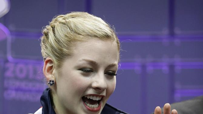 Gracie Gold, of the United States, reacts to her scores during the free skate program in the ladies competition at the World Figure Skating Championships Saturday, March 16, 2013, in London, Ontario. (AP Photo/Darron Cummings)