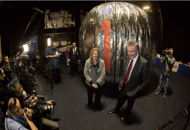 NASA deputy administrator, Lori Garver, left, and Bigelow Aerospace president Robert Bigelow, pose for photos and video in front of the Bigelow Expandable Activity Module during a news conference, Wed