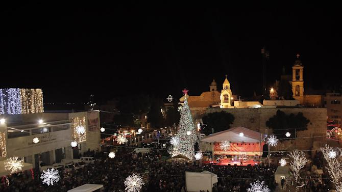 A view of Manger Square and the Church of the Nativity as people gather for Christmas eve celebrations in the biblical West Bank city of Bethlehem, believed to be the birthplace of Jesus Christ, on December 24, 2014