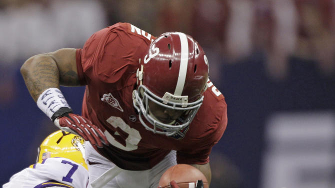 Alabama's Trent Richardson (3) is tackled by LSU's Tyrann Mathieu (7) during the first half of the BCS National Championship college football game Monday, Jan. 9, 2012, in New Orleans. (AP Photo/David J. Phillip)
