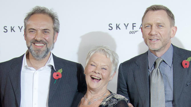 """FILE - This is a Thursday, Nov. 3, 2011. file photo of Film  Director Sam Mendes, with actors Dame Judi Dench and Daniel Craig at the photo call for the new James Bond film titled Skyfall, at a central London restaurant venue.  Never say never again? Sam Mendes says he won't be directing the next James Bond film — but may work on the series again in future. In comments published Wednesday March 6, 2013  by movie magazine Empire, Mendes said he was honored to have been part of the Bond family, """"and very much hope I have a chance to work with them again."""" (AP Photo/Joel Ryan, File)"""