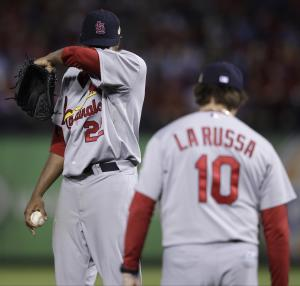 St. Louis Cardinals starting pitcher Edwin Jackson wipes his head as manager Tony La Russa come to the mound to take him out of the game during the sixth inning of Game 4 of baseball's World Series against the Texas Rangers Sunday, Oct. 23, 2011, in Arlington, Texas. (AP Photo/Matt Slocum)