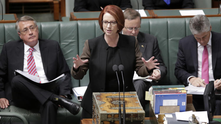 Australian Prime Minister Julia Gillard speaks in parliament in Canberra, Australia, Wednesday, June 26, 2013. Supporters of Gillard's chief intra-party rival are again pushing for a vote to oust the Australian prime minister this week. (AP Photo/Rick Rycroft)