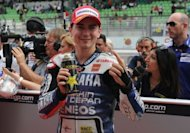 MotoGP leader Jorge Lorenzo has seizes pole position for Sunday's Malaysian Motorcycle Grand Prix, with the Yamaha rider putting in a record lap in qualifying